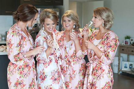 Bridesmaids in floral pink silk robes