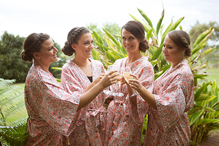 Bridesmaids in navy floral silk robes