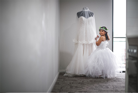 Flower Girl with Brides Gown