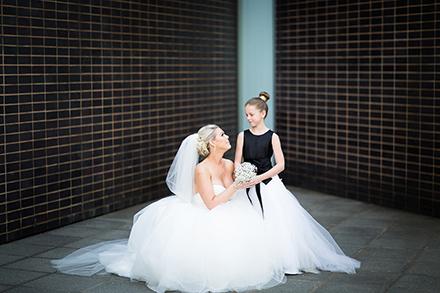 flower girl with kneeling Bride
