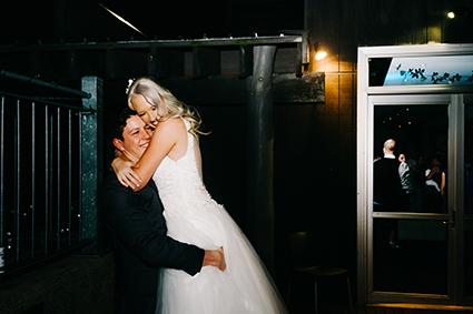 Bride, & Groom Hugging